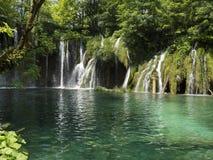 Waterfall into lake Royalty Free Stock Image
