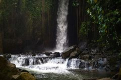 Waterfall landscape. Beautiful hidden Sumampan waterfall in tropical rainforest in Bali near Ubud royalty free stock photography