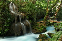 Waterfall landscape with bridge on it Royalty Free Stock Images