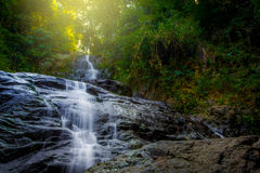 Waterfall landscape. Waterfall in the forest and light fair Stock Photography