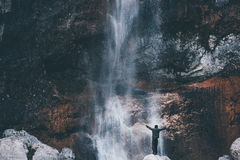 Waterfall Landscape and Traveler hands raised. Enjoying waterfall view Travel Lifestyle adventure concept active vacations into the wild harmony with nature Stock Photography