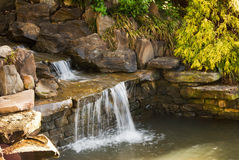 Waterfall in a Landscaped Rock Garden Royalty Free Stock Photos