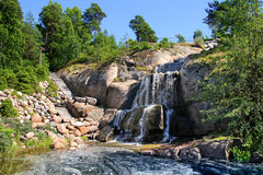 Waterfall in landscaping park. Waterfall cascading over rocks in Sapokka landscaping park Kotka Finland royalty free stock photo