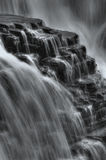 Waterfall. A large waterfall with flat rocks Stock Photography