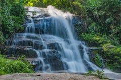 Waterfall through layers of rocks stock photo