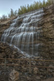 Waterfall at Le Cres, France. A small waterfall by the lake of Le Cres village in Languedoc, France royalty free stock photos