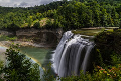 Waterfall in Letchworth State Park. The middle falls with a rainbow in Letchworth State Park during summer Stock Photos