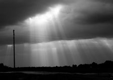 Waterfall of light. Sun rays blasting to the clouds royalty free stock photography