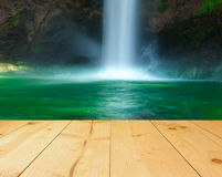 Waterfall with light yellow color wood terrace texture background Royalty Free Stock Photo
