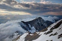 Waterfall-like clouds flowing down the steep Karavanke ridge Royalty Free Stock Photo