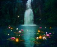 Waterfall and lilies Royalty Free Stock Photography