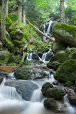 Waterfall. Little stream running through the rocks Stock Photography