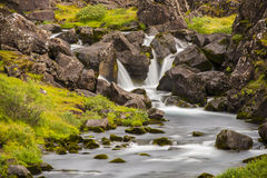 Waterfall Long Exposure iwth grass and rocks Royalty Free Stock Photo