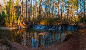 Waterfall in Lullwater Park, Atlanta, USA. Panoramic view of the spillway waterfall and the tower in the Lullwater Park, Atlanta, USA Stock Photos
