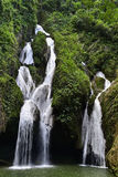 Waterfall in a lush rainforest. Royalty Free Stock Images