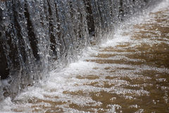 Waterfall macro background. Falling water in the fountain macro background royalty free stock photo