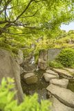 Waterfall of the Meijiro garden that flows into the central pond stock photo