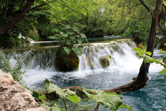Waterfall in the middle of the lake. Picturesque waterfall in the middle of the lake - Plitvicka Jezera Stock Photography
