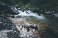 Waterfall in the middle of river in Asturias stock photos