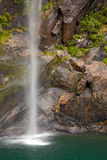 Waterfall at Milford sound New Zealand Royalty Free Stock Images