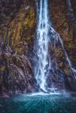 Waterfall in Milford Sound in New Zealand stock image