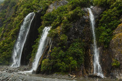 Waterfall in Milford Sound, New Zealand. Under the waterfall in Milford Sound, south island in New Zeland. Beautiful landscape Stock Image