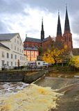 Waterfall at the mill, Uppsala, Sweden. The Waterfall at the old academy mill with Uppsala Cathedral in the background royalty free stock photography