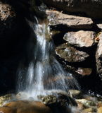 Waterfall. A mini waterfall at the Saramento Zoo Stock Image
