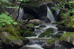 Waterfall and moss-covered rocks Royalty Free Stock Images