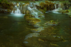 Waterfall on mossy background Stock Image