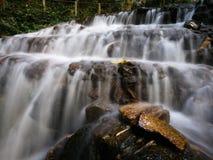Waterfall mossy rocks. Beautiful waterfall mossy rocks Royalty Free Stock Images