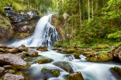 Waterfall with mossy rocks in Golling, Austria.  Stock Photography
