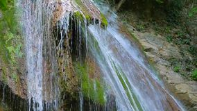 Waterfall, mossy rocks stock video footage