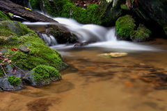 Waterfall and mossy stones Stock Photo