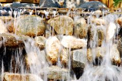 Waterfall in motion. Close up of waterfall cascading over rocks, slow motion blur effect Royalty Free Stock Images