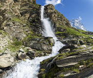 Waterfall and Mount Cervino, Valtournenche Stock Photography