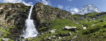 Waterfall and Mount Cervino, Valtournenche Royalty Free Stock Photo