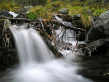 Waterfall in mountain Stock Photo