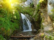 Waterfall in a mountain Stock Images