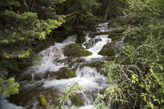 Waterfall in mountain background Royalty Free Stock Photography
