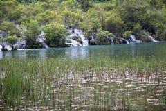 Waterfall in mountain Stock Photo