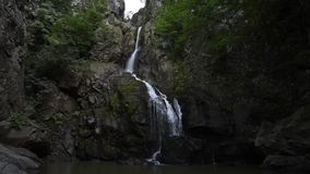 Waterfall at mountain stock footage
