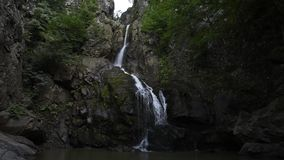 Waterfall at mountain stock video footage