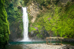 Waterfall in a mountain gorge, Philippines. Royalty Free Stock Images