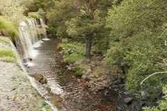 Waterfall in mountain lake and green park in Rascafria. Royalty Free Stock Photos