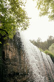 Waterfall in mountain lake and green park in Rascafria. Royalty Free Stock Image