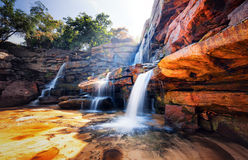 Waterfall and mountain landscape Stock Photo