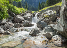 Waterfall in the mountain Royalty Free Stock Images