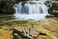 Waterfall on the mountain river Stock Images