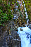 The waterfall and mountain river in the Alps, Bavaria, Germany Royalty Free Stock Images